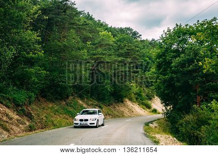 Verdon France - June 29 2015: White colour BMW car on background of French mountain nature landscape