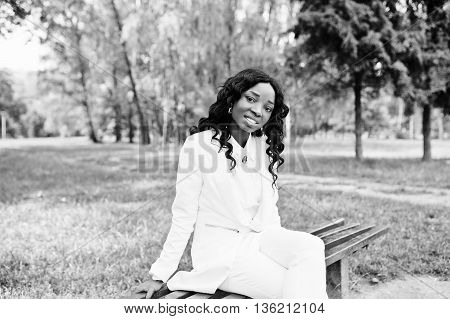 Portrait Of Pretty Black African American Girl Sitting On Bench At Green Park