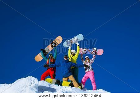 Happy people with snowboards outdoors