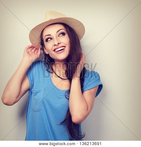 Happy Toothy Smiling Woman In Hat Thinking And Looking Up. Toned Vintage Portrait