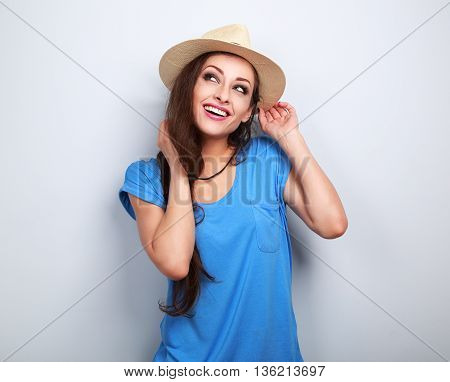 Happy Toothy Smiling Woman In Hat Thinking And Looking Up