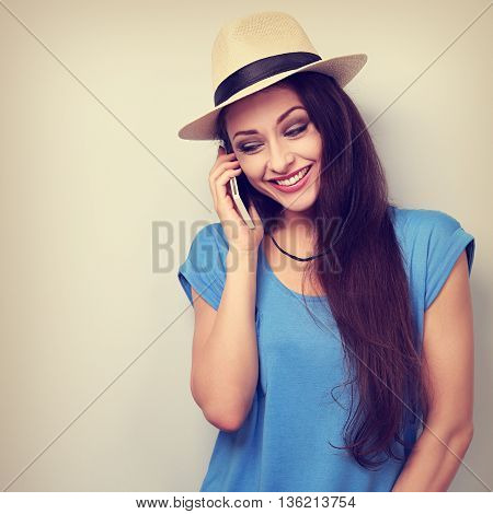 Fun Laughing Woman In Hat Speaking On Mobile Phone. Toned Closeup Portrait
