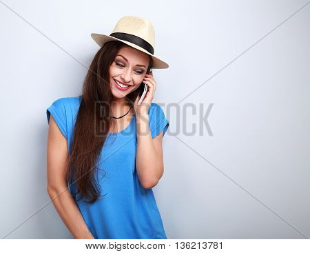 Fun Laughing Woman In Hat Speaking On Mobile Phone On Blue Background