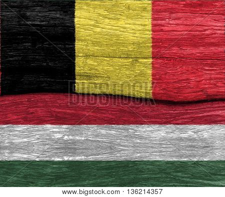 belgium and hungary flag on old wood texture pattern background - can use to display or montage product