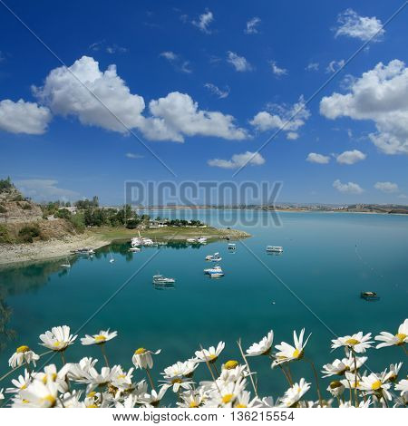 boats on a lake over clear sky