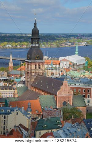 RIGA, LATVIA - MAY 02, 2014: The steeple of the Dumskaya cathedral, sunny day in may in the old Riga. Historical landmark of the Latvia