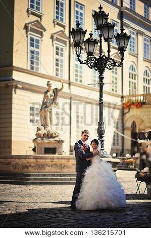 Wedding couple under big city lanterns at wedding