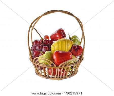 mixed fruits in rattan basket on white background