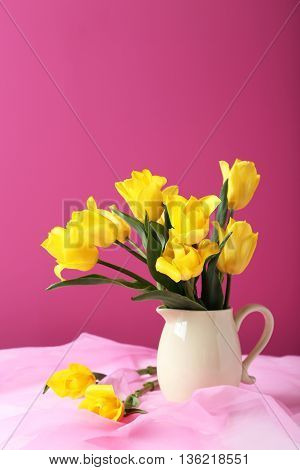Bouquet Of Yellow Tulips On A Pink Background