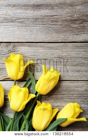 Bouquet Of Yellow Tulips On A Grey Wooden Table