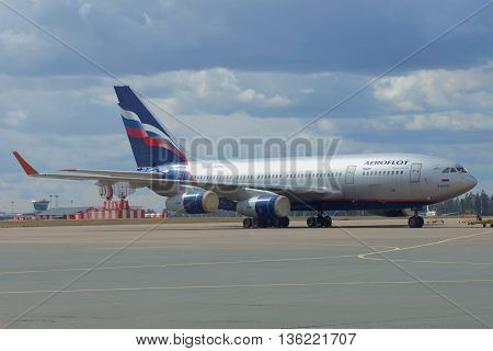 MOSCOW, RUSSIA - APRIL 15, 2015: The IL-96-300 (RA-96015) company Aeroflot - Russian Airlines parked at the airport Sheremetyevo