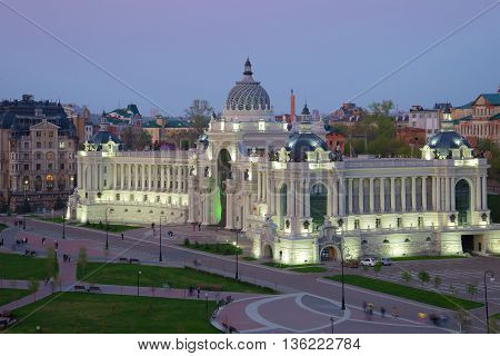 KAZAN, RUSSIA - MAY 02, 2016: Palace of farmers in the pink the may twilight. Historical landmark of the city Kazan, Tatarstan