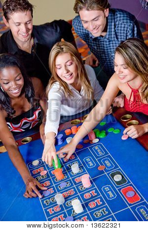 Group of casino gamblers on the roulette