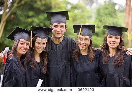 graduation students looking very happy outdoors