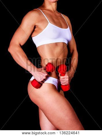 Strong woman with red barbells, black background