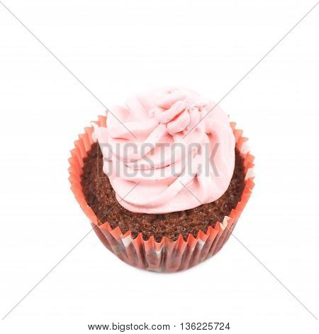 Single chocolate muffin coated with the pink cream frosting, composition isolated over the white background