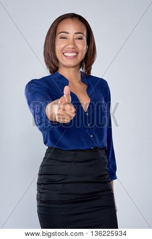 Happy smiling businesswoman with thumbs up gesture, isolated in studio