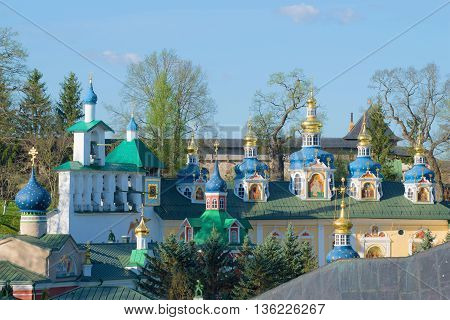 Dome of the old Holy Dormition Pskovo-Pechersky monastery, sunny may morning. Pechory, Russia
