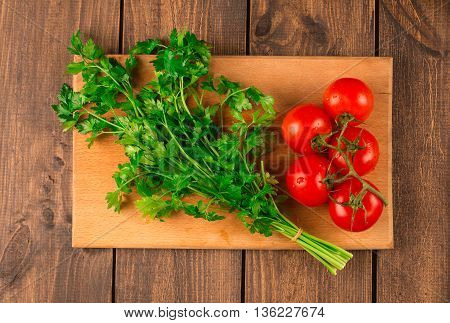 Fettuccine pasta with shrimp tomatoes and herbs. wooden background. Top view