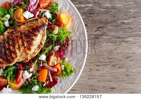 Grilled Chicken Breast fillet with fresh tomatoes vegetables salad. concept healthy food
