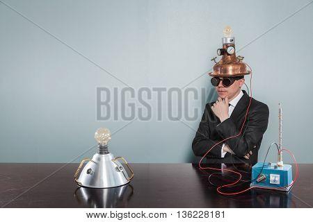 Vintage businessman sitting at office desk with machine
