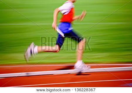 Relay race, motion blurred image of runner.  Track and Field