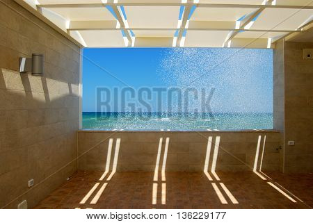 A window on the sea in the promenade of Torre Canne in Apulia - Italy