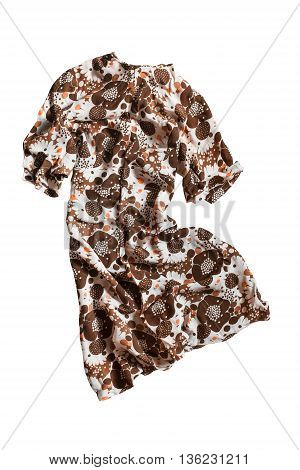 Brown silk dress folded on white background