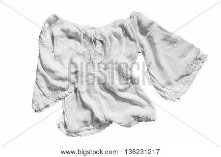 White ethnic blouse folded on white background
