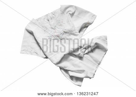 Folded white embroidered silk blouse isolated over white