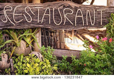 Restaurant sign on Thailand beach in Koh Phayam