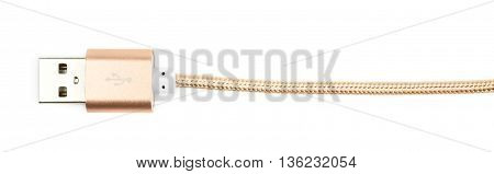 Close-up fragment of the golden USB cable isolated over the white background