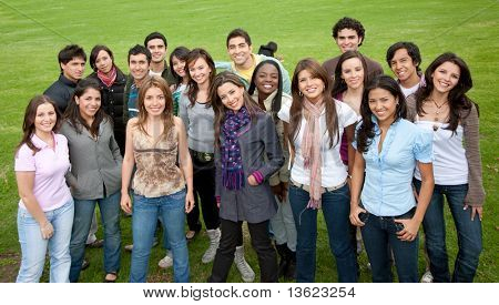 Large group of people smiling outdoors