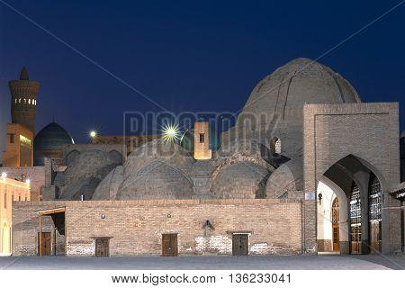 Domed bazaar at the twilight in Bukhara, Uzbekistan.