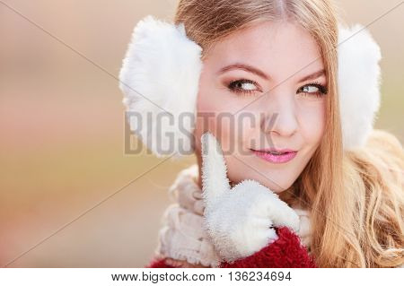 Portrait Of Suspicious Pretty Woman In Earmuffs