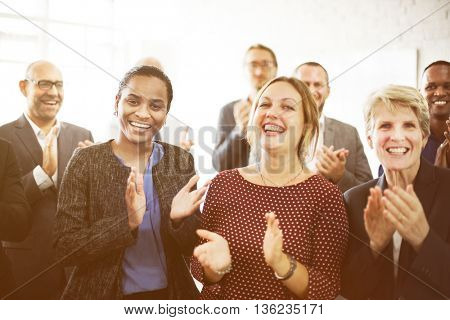 Business People Team Applauding Achievement Concept