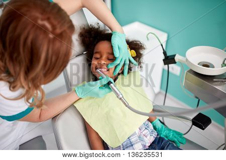 Dental polishing treatment in dental clinic to child patient