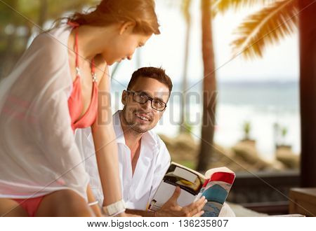 Cheerful couple at tropical resort enjoying together