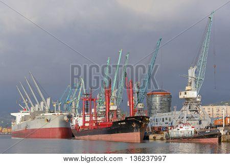 Batumi Georgia - June 27 2016: Batumi industrial sea port with ships and cranes Black Sea harbour
