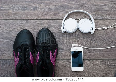 Sport. Outfit for exercises. Equipment for jogging on wooden background
