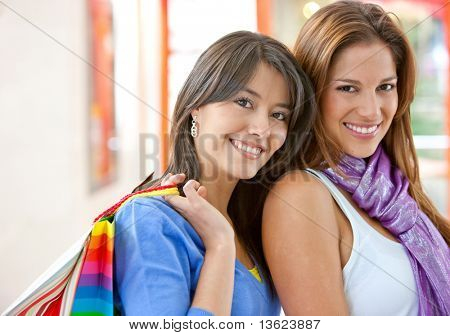 Beautiful Shopping women with bags in a shopping centre