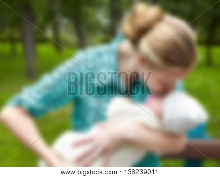 Happy mother and infant. Fuzzy photo. Blur
