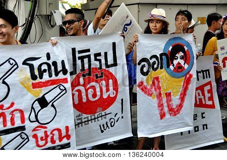 Bangkok Thailand - January 13 2014: Demonstrators holding anti-government signs during the enormous Operation Shut Down Bangkok protest