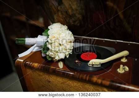 Wedding Bouquet With Rings At Olf Vintage Gramophone
