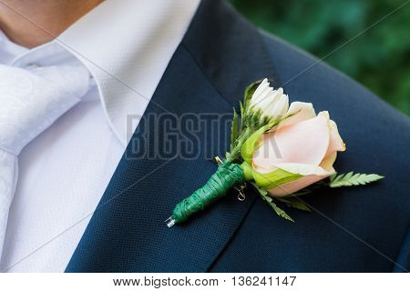 small rose on his jacket the groom