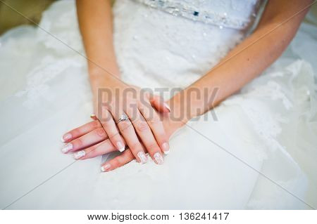 Hands of bride with ring at wedding