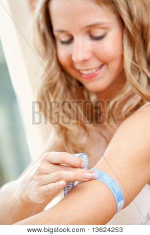 Gorgeous woman measuring her biceps smiling