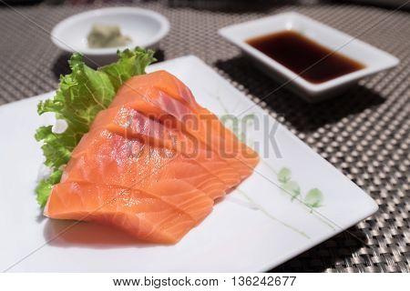 Salmon Sashimi On White Dish (japanese Foods)