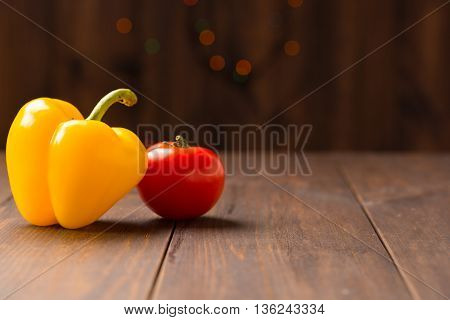 yellow peppers and tomato  vegetables wood backgraund