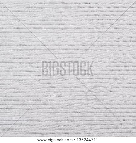 Fragment of a white gray striped cloth fabric material texture as an abstract background composition